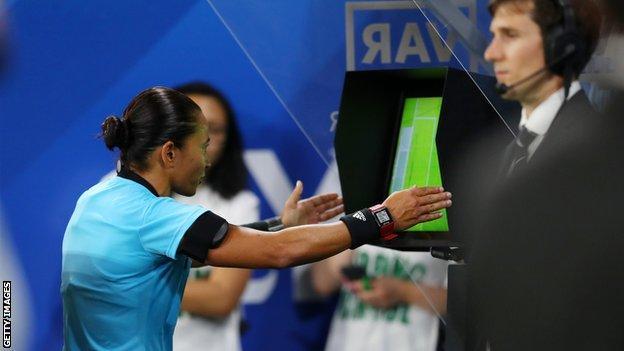 Referee uses views VAR monitor