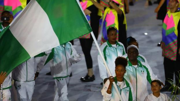 Nigerian table tennis player Funke Oshonaike carrying the Nigerian flag at the Rio Olympics opening ceremony