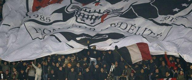 Nice fans unfurl a huge banner during their game with Paris St-Germain