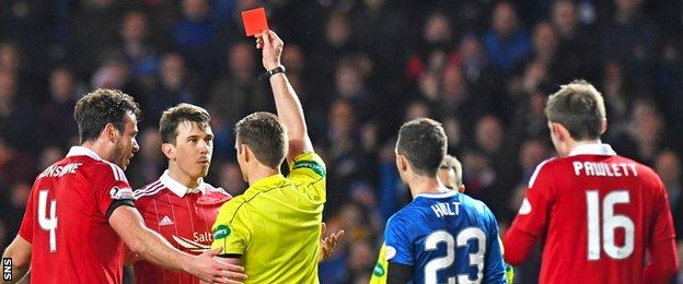Ryan Jack is shown a red card