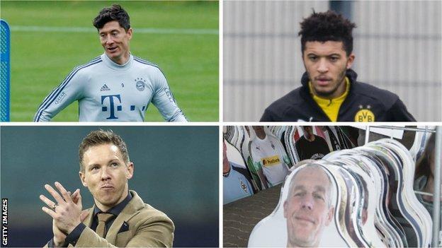 Robert Lewandowski, Jadon Sancho, Julian Nagelsmann and cardboard cut-outs of Borussia Monchengladbach fans