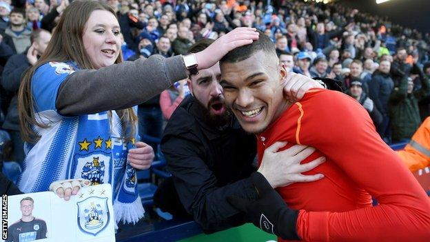 Collin Quaner celebrates after full-time with Huddersfield fans