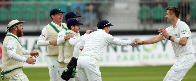 Boyd Rankin (right) is congratulated by his team-mates after taking the wicket of Haris Sohail