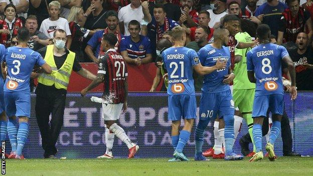 The brawl involving players and spectators forced the Ligue 1 match to be abandoned