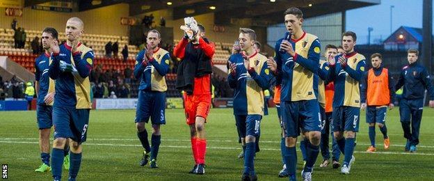 The East Kilbride players applaud their fans in Airdrie after the cup exit