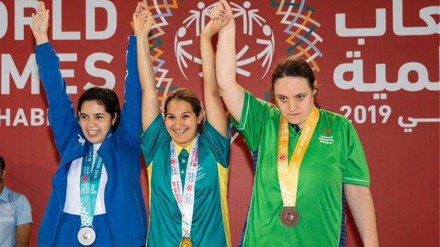 Ballygowan swimmer Emma Carlisle (right) finished the Games with a gold and a bronze