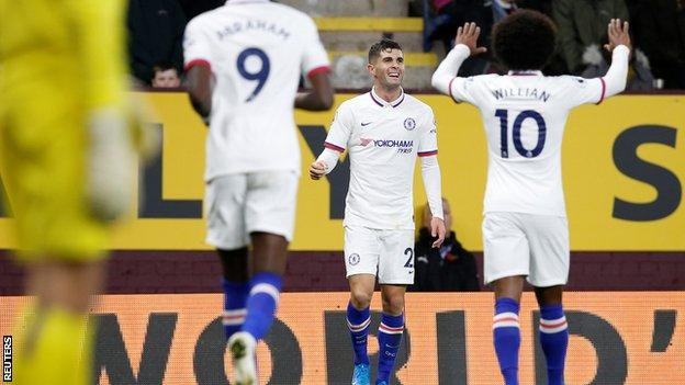 Christian Pulisic celebrates scoring with Willian and Tammy Abraham