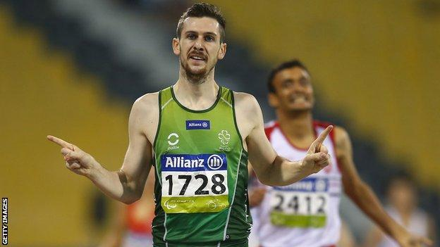 Michael McKillop celebrates as he retains his T38 800m world title in Doha