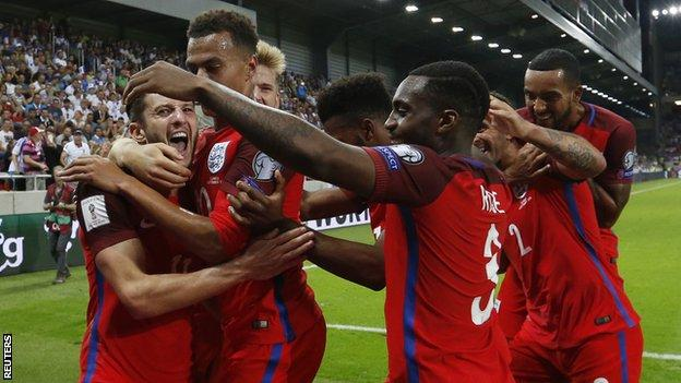 Adam Lallana (left) is congratulated by England team-mates after his winner in Slovakia