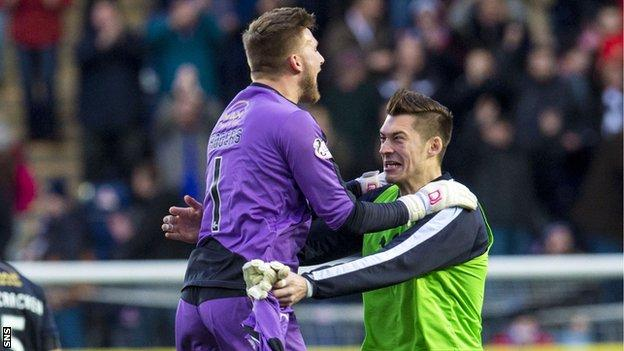 Falkirk's Danny Rogers (left) celebrates at the final whistle