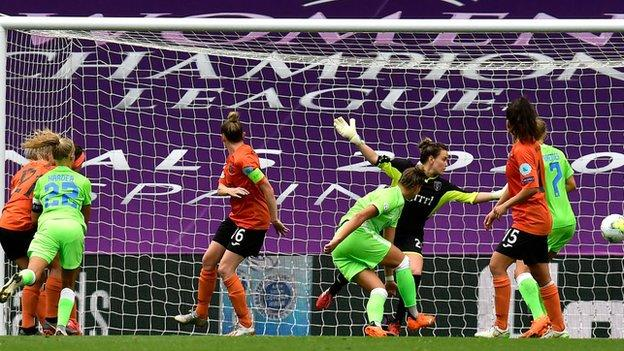 Four goals from Pernille Harder, left, helped Wolfsburg into the last four