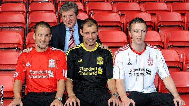 Joe Cole poses with Liverpool boss Roy Hodgson