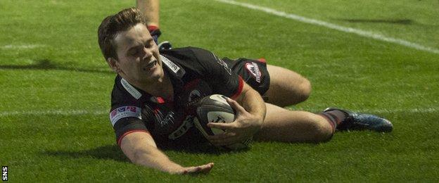 Edinburgh's Chris Dean scores a try