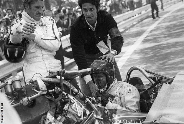 Graham Hill, Jochen Rindt, Lotus-Ford 49B, Grand Prix of Spain, Montjuic, 04 May 1969. Jochen Rindt after his accident caused by a rear wing failure