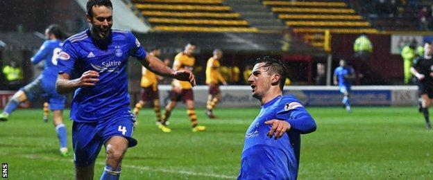 Andrew Considine runs to celebrate with Kenny McLean after his goal