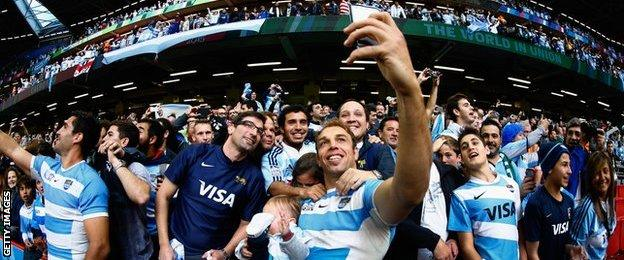 Argentina players takes selfies with fans after victory over Ireland at 2015 World Cup