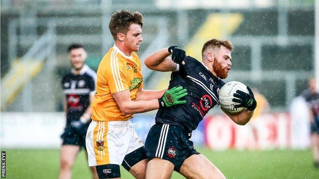 Kilcoo's Aaron Morgan in action against Clonduff's Patrick O'Hagan at Pairc Esler