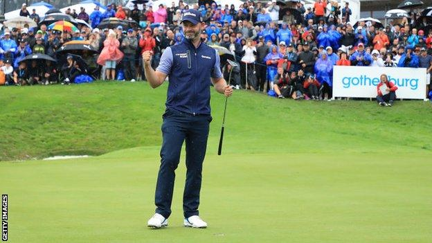 Paul Waring celebrates on the green after securing the 2018 Nordea Masters