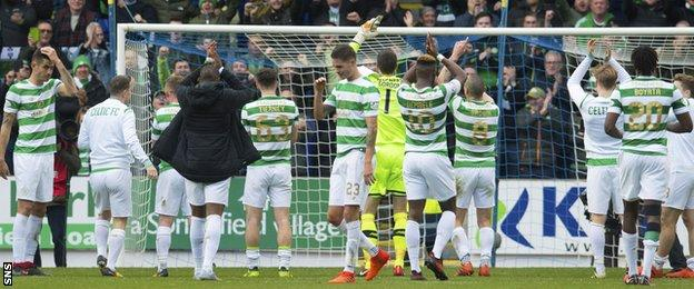 Celtic players celebrate with their fans