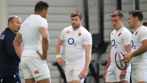 Eddie Jones (left) and England players at training