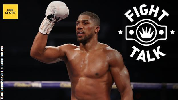 Anthony Joshua celebrates victory