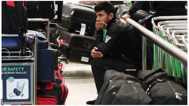 A Bangladesh player sits in silence at Christchurch airport
