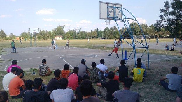 Refugees play tape-ball cricket in the Obrenovac camp