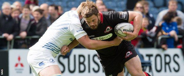 Ross Ford carries into contact for Edinburgh