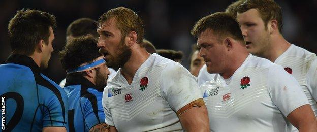 England captain Chris Robshaw and his team-mates walk off the pitch after victory over Uruguay in theri final group game