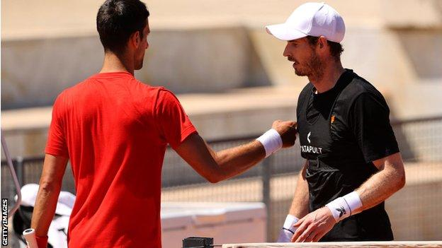 Andy Murray and Novak Djokovic at the net