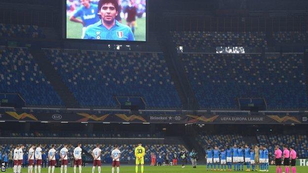Napoli and Rijeka players observe a minute's silence in memory of Diego Maradona at the San Paolo stadium