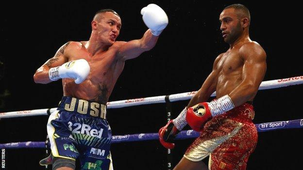 Josh Warrington throws a punch during his fight with Kid Galahad