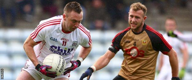 Paul Kerrigan attempts to turn Down's Gerard McGovern in the Division One game at Pairc Ui Rinn