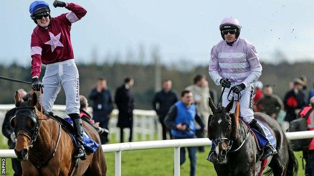 Ger Fox celebrates with Rogue Angel with Ruby Walsh behind on Bless The Wings