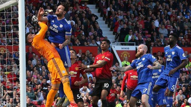 Neil Etheridge makes a save for Cardiff