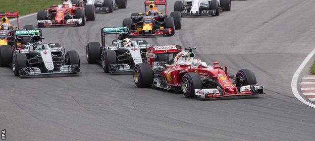 Sebastian Vettel leads into the first corner