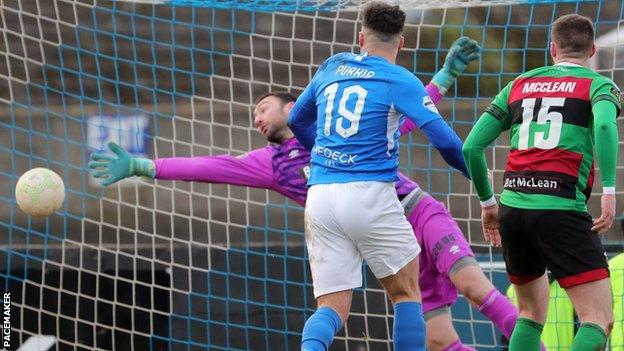 Glens keeper Marijan Antolovic can't keep out Daniel Purkis' header to bring Glenavon level