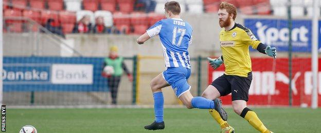 Coleraine's Brad Lyons rounds Cliftonville keeper Conor Devlin as he is about to stroke in the Bannsiders' third goal at Solitude