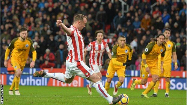 Charlie Adam takes a penalty
