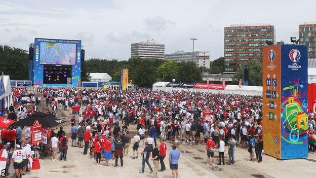 Fans in the fan zone in Lille ahead of the clash between England and Wales