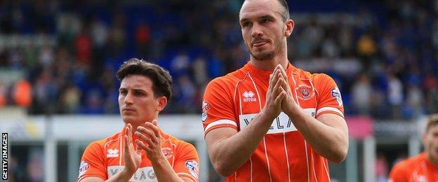 Blackpool players applaud their fans following their relegation to League Two
