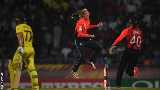 Sophie Ecclestone celebrates after dismissing Australia's Alyssa Healy