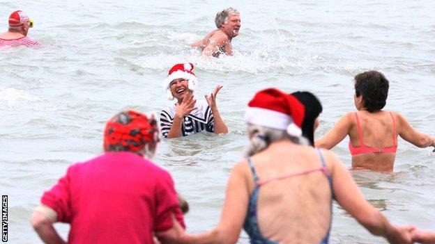 Swimmers taking part in a Christmas Day swim in Bournemouth