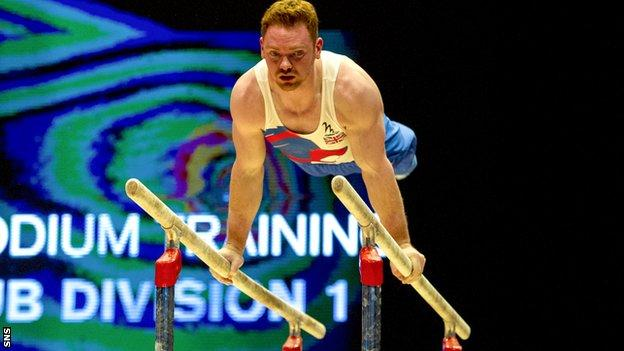 Team GB gymnast Daniel Purvis practices on the parallel bars