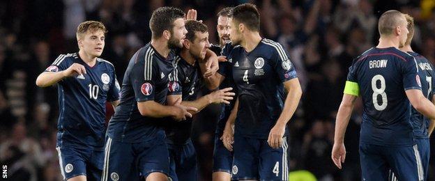 James McArthur celebrates his goal against Germany with Scotland team-mates