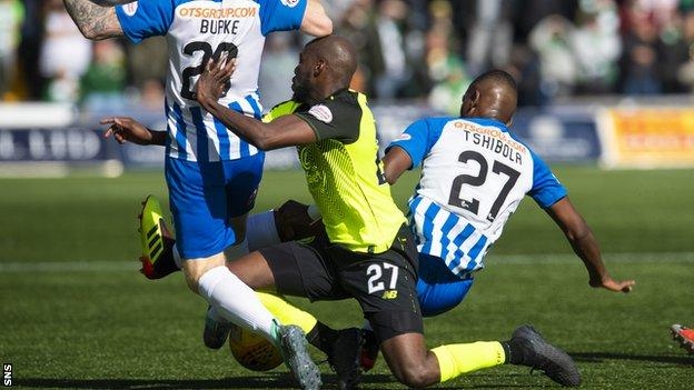 Youssouf Mulumbu makes a tackle for Celtic against Kilmarnock