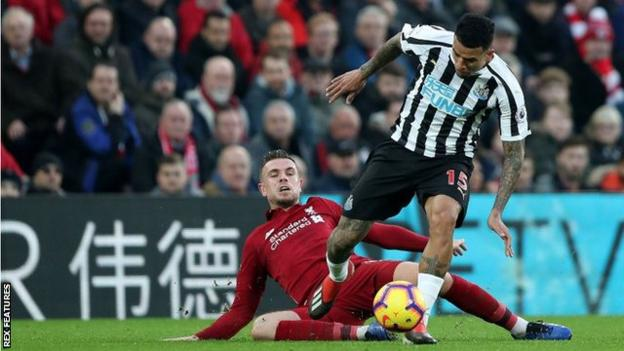 Jordan Henderson in action for Liverpool against Newcastle