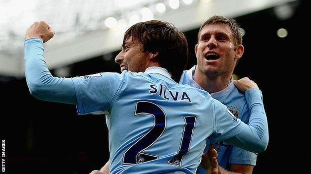 David Silva and James Milner celebrating for Manchester City