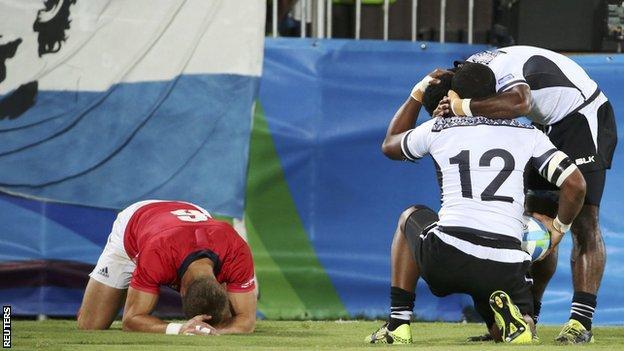 Team GB's Tom Mitchell reacts with despair as Vatemo Ravouvou scores for Fiji