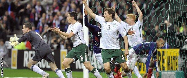 Republic of Ireland players protest after Henry's handball sets up William Gallas for France's decisive goal in a World Cup qualification play-off